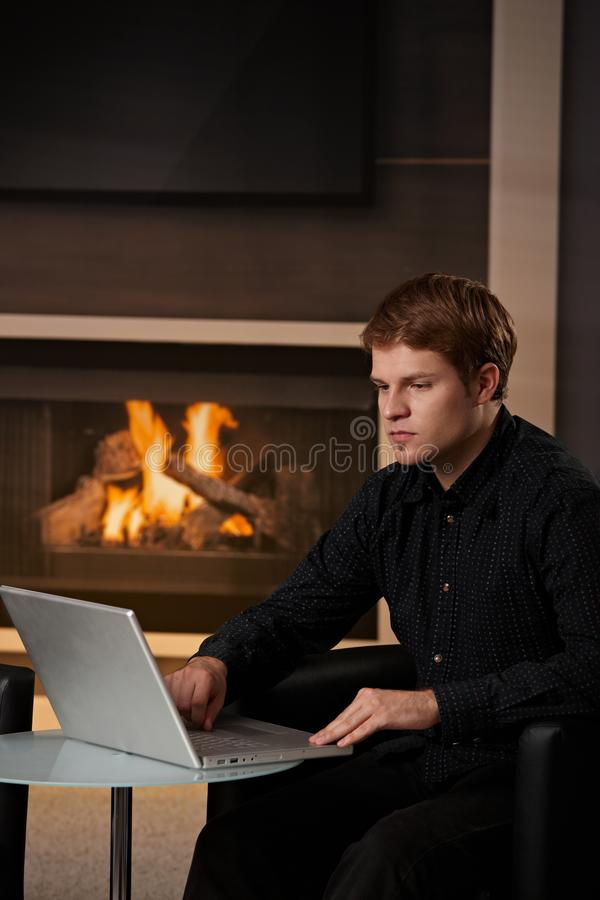 Man using computer at home royalty free stock photography