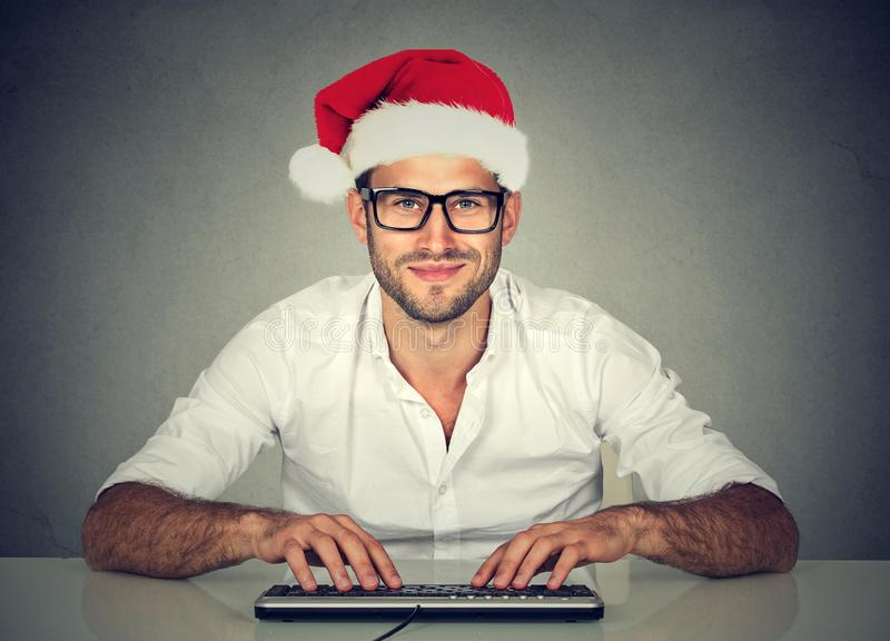 Man using computer shopping online looking for a christmas gift. royalty free stock photo