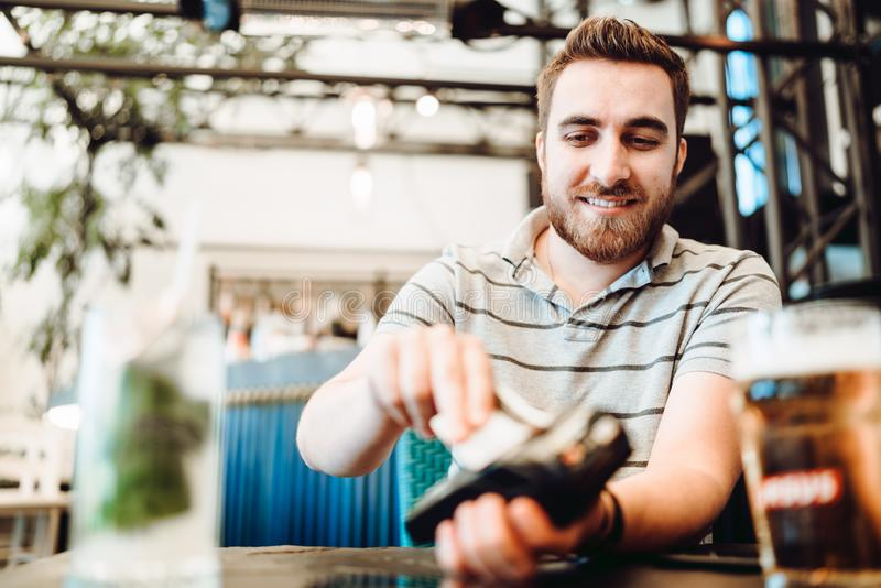 Man using credit card for paying at restaurant royalty free stock photos