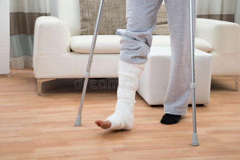 Man using crutches for walking stock photo