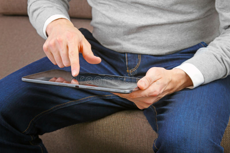 Download Man using digital tablet stock image. Image of couch - 39247849