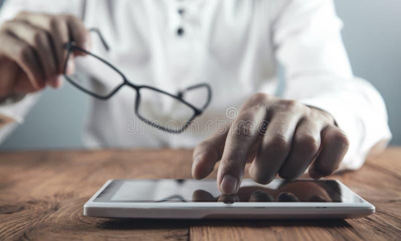 Man using digital tablet. Technology royalty free stock image