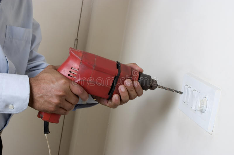 Man Using Drill Machine Royalty Free Stock Images