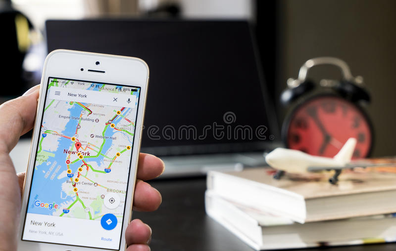 A man using google maps for business travel. stock photography
