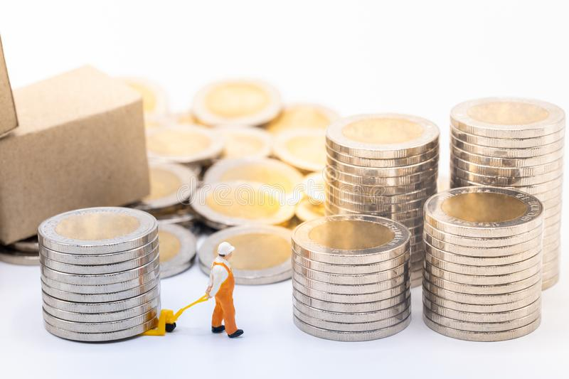 Man using hand-lift dragging stack of coins. royalty free stock image