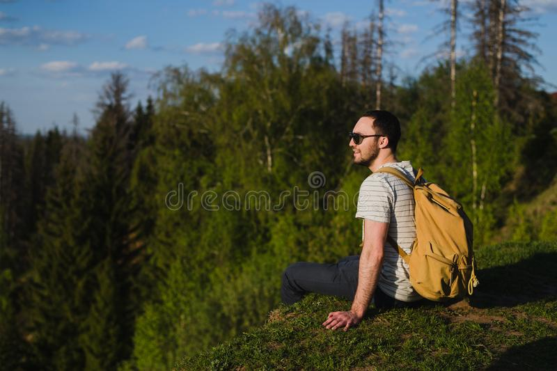 Man using hiking with backpack outdoors in woods stock photography