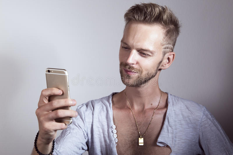 Man using his mobile phone stock photo