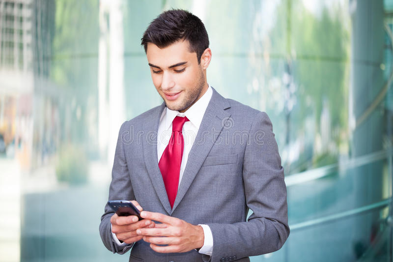 Man using his mobile phone royalty free stock photos