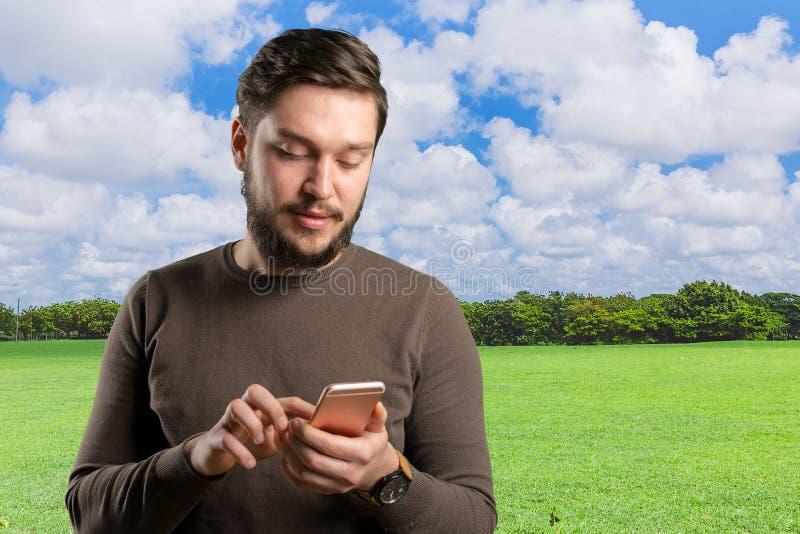 man using his smartphone royalty free stock image