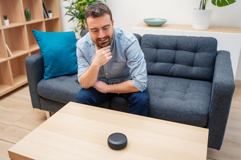 Man using home assistant bluetooth speaker royalty free stock image
