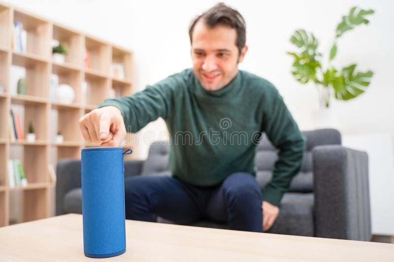 Man using home assistant bluetooth speaker royalty free stock photography