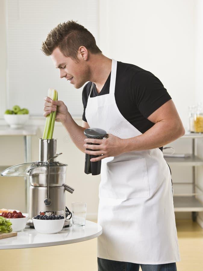 Man Using Juicer stock image