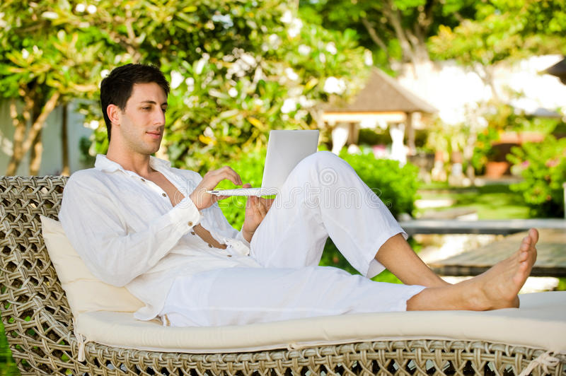 Download Man Using Laptop stock photo. Image of lounging, young - 14730406