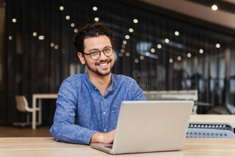 Man using laptop computer in office royalty free stock photo