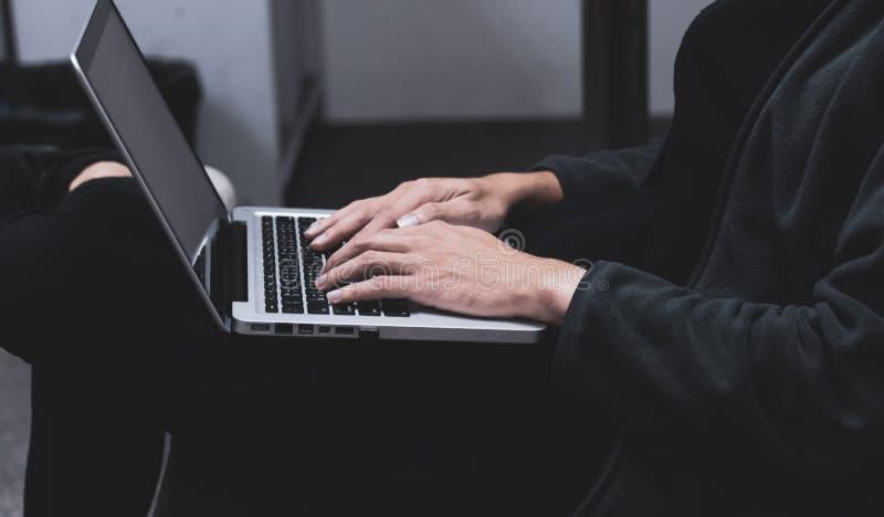 Man using laptop computer searching stock photo
