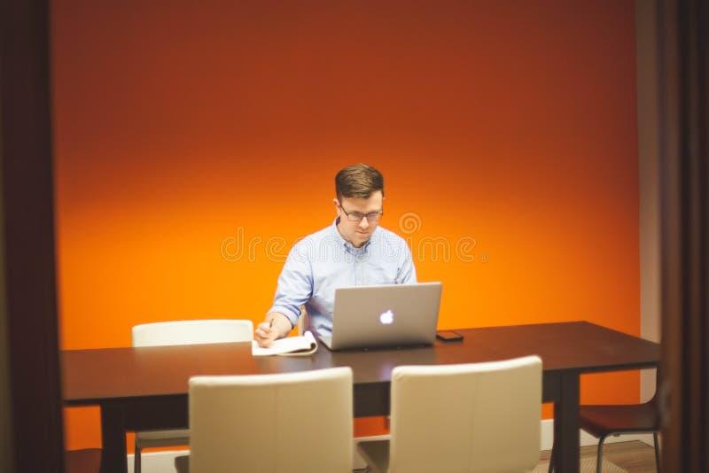 Man using laptop at desk royalty free stock photo