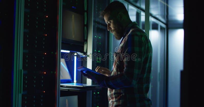 Man using laptop on mining farm in data center stock images