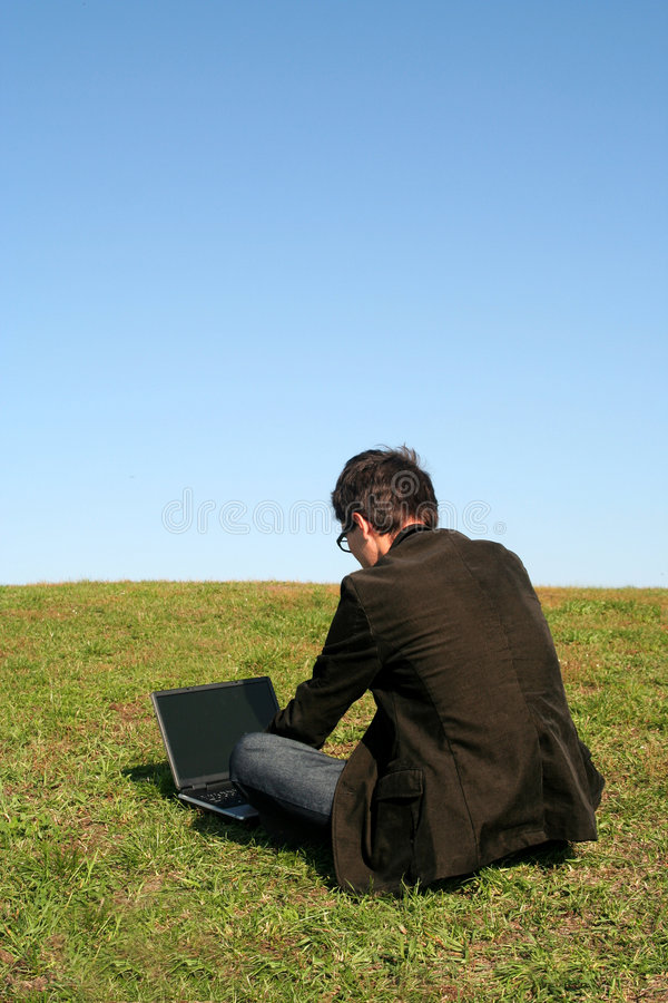 Man Using A Laptop Outdoors Stock Image