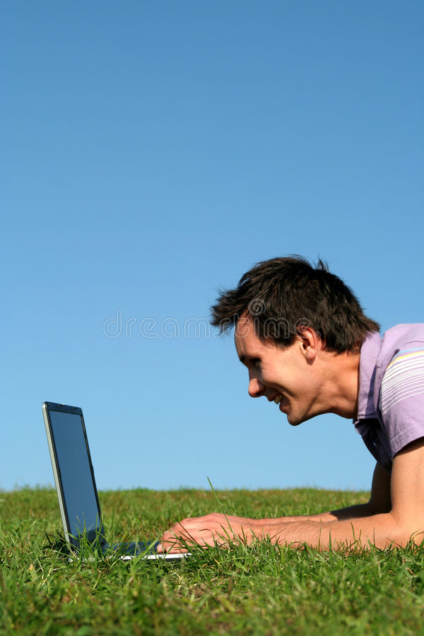 Man using a laptop outdoors stock photo