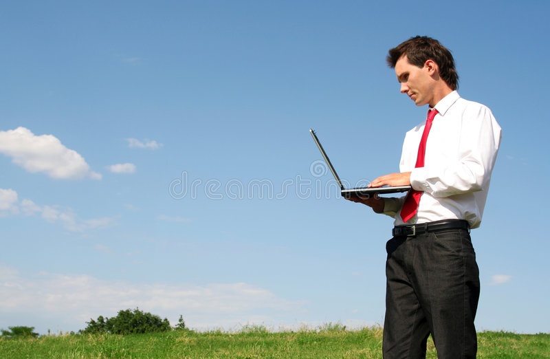 Download Man using laptop outdoors stock photo. Image of computer - 2586376