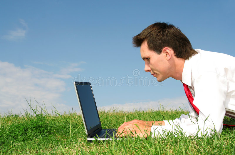 Download Man Using Laptop Outdoors Royalty Free Stock Images - Image: 2587729