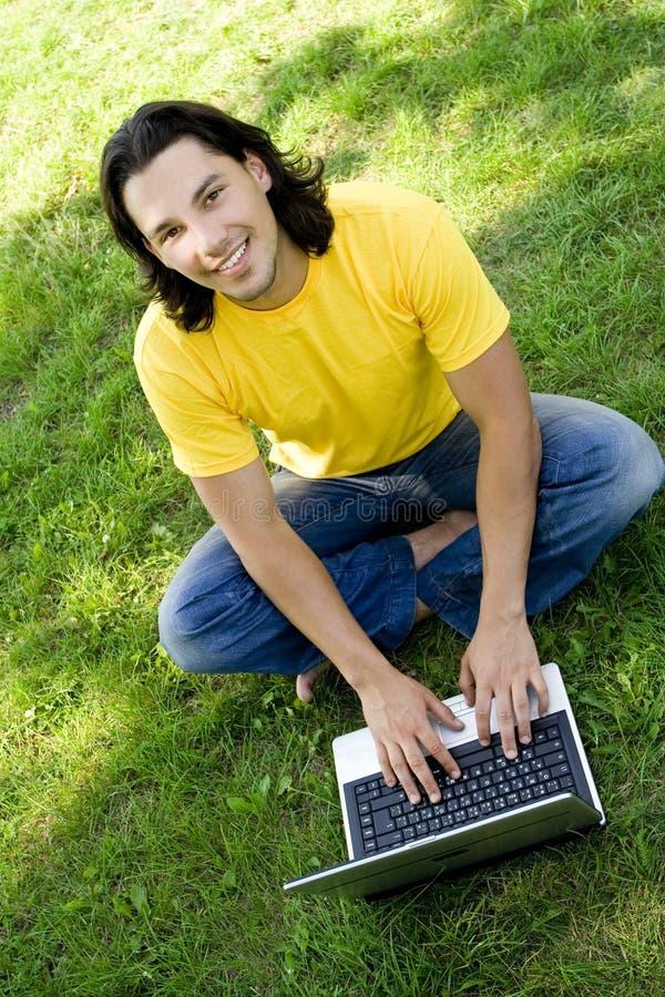 Download Man using laptop outdoors stock image. Image of teenage - 5986601