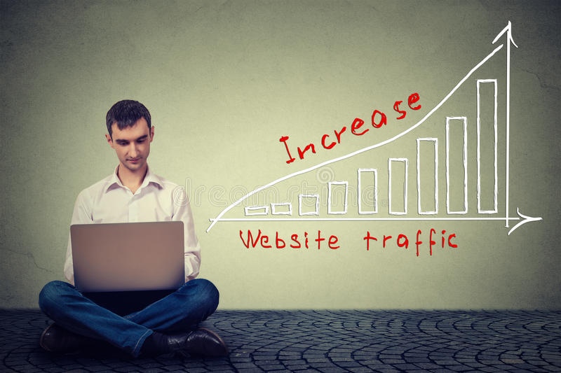 Man using laptop working on a plan to increase website traffic. Technology marketing concept royalty free illustration
