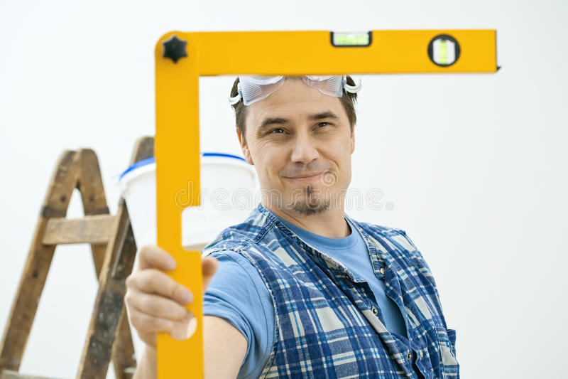 Download Man using level tool stock image. Image of horizontal - 9783437