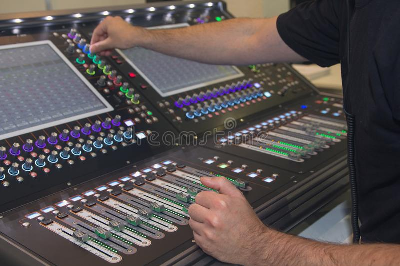 Man using mixing console in sound recording studio royalty free stock image