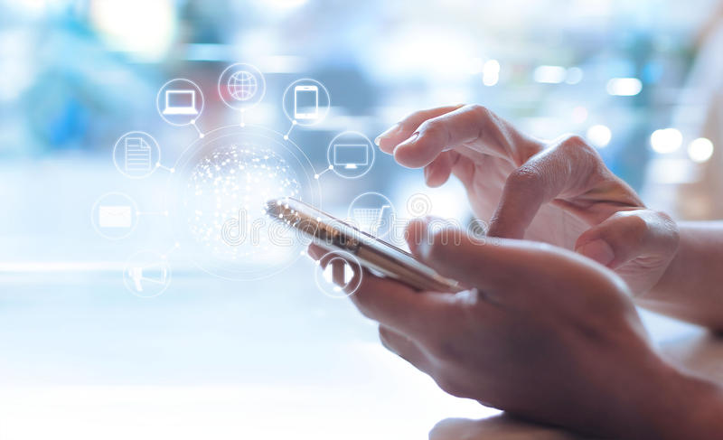 Man using mobile payments, holding circle global and icon customer network connection. Omni Channel stock photos