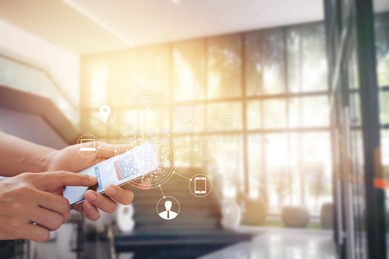 Man using mobile payments online shopping and icon customer network connection on screen, m-banking and omni channel. All on mobile screen are designed up royalty free stock image