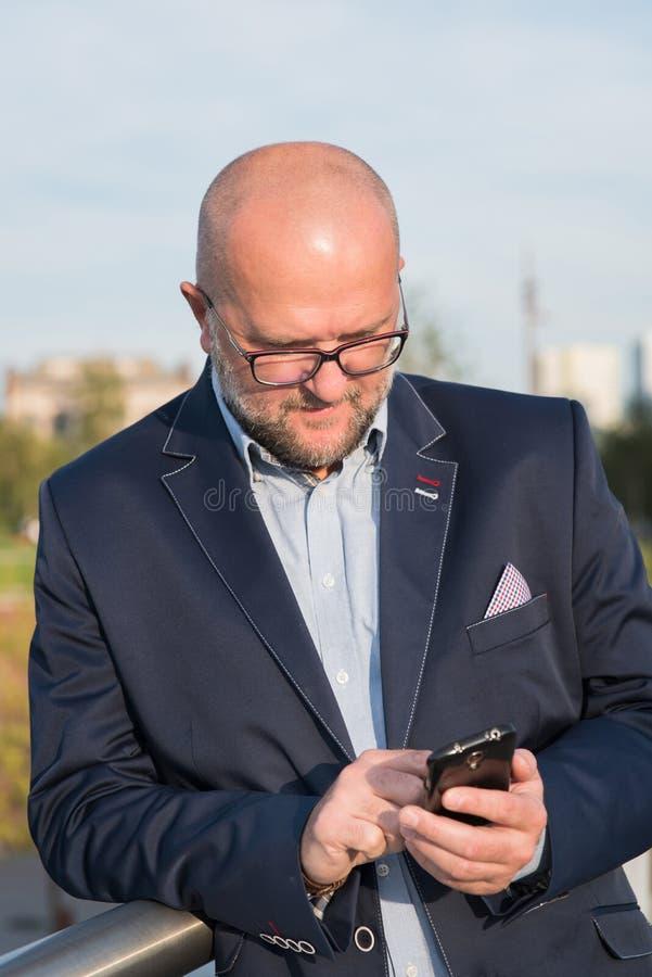 Man using mobile phone. stock photos