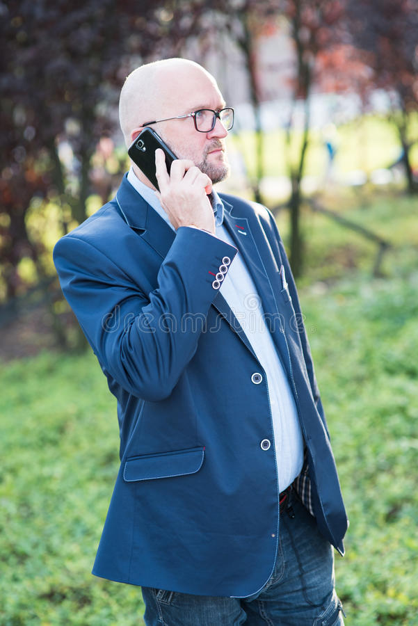 Man using mobile phone. stock photography