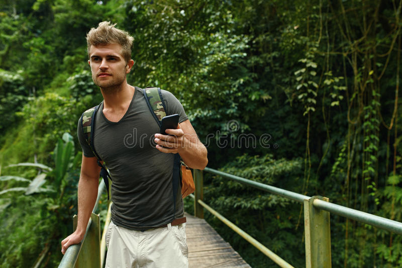 Man Using Mobile Phone, Smartphone In Nature. Travel, Tourism. Man Using Mobile Phone For Communication. Tourist Male Holding Smartphone On Summer Travel royalty free stock images