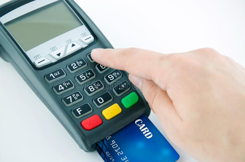 Man using payment terminal keypad. Enter personal identyfication number royalty free stock photo