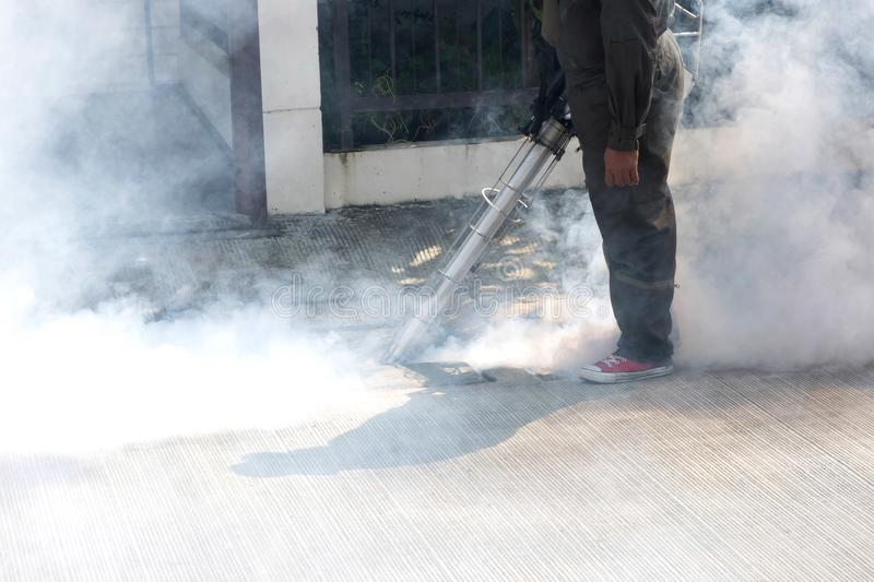Man using pest control machine. Man using smoke machine of pest control for mosquito preventive stock photos