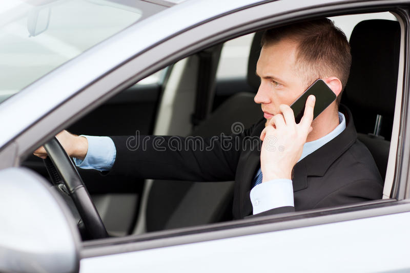 Download Man Using Phone While Driving The Car Stock Image - Image: 34106515