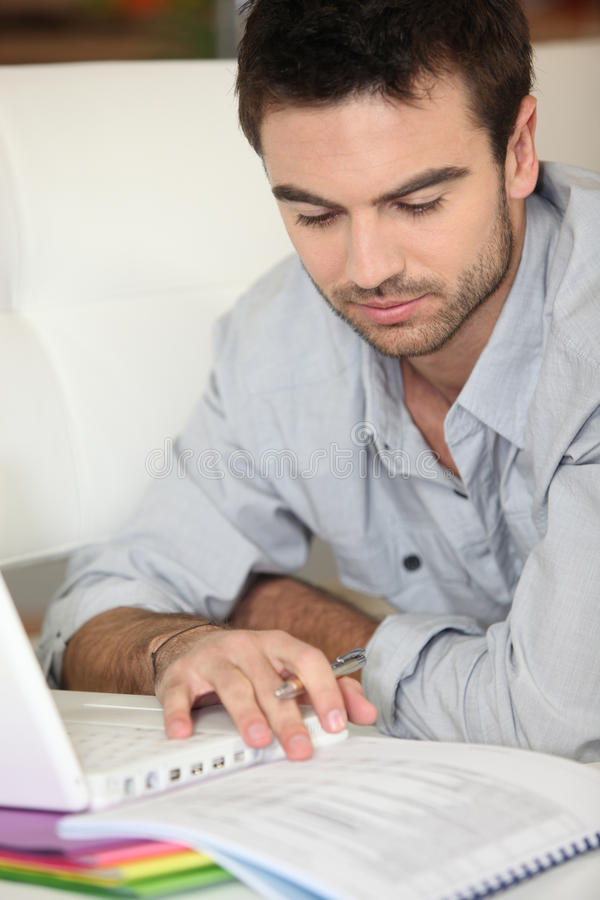 Man using portable computer royalty free stock images