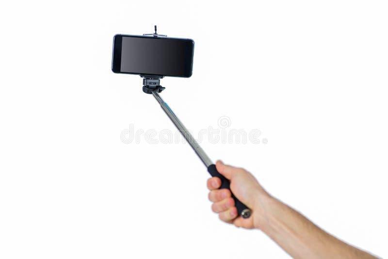 Man using a selfie stick. Shot in studio stock photos