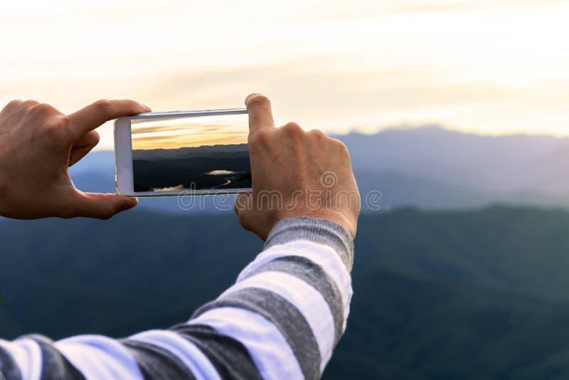 Man using smart phone take a photo royalty free stock photos