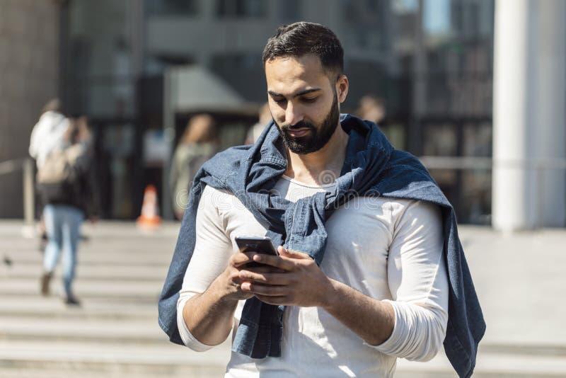 Man Using Smartphone stock photography