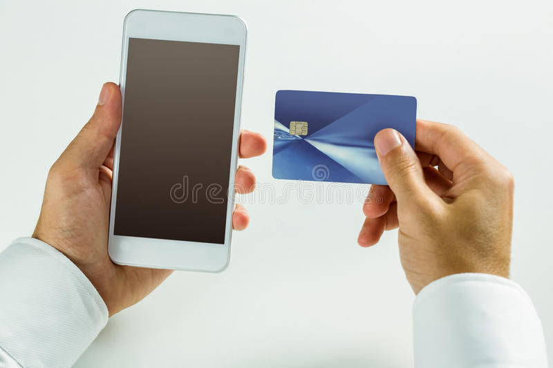 Man using smartphone for online shopping royalty free stock images