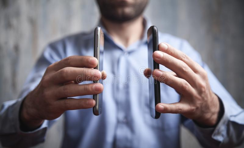 Man using smartphones. Technology concept stock photos