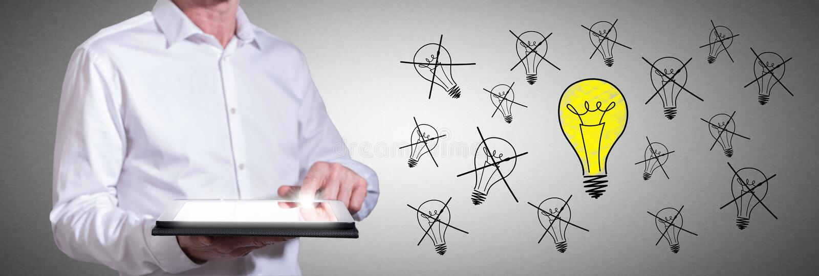 Best idea concept with man using a tablet. Man using a tablet with best idea concept stock photo