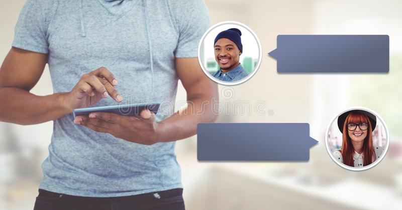 Man using tablet with chat bubble messaging profile royalty free stock image