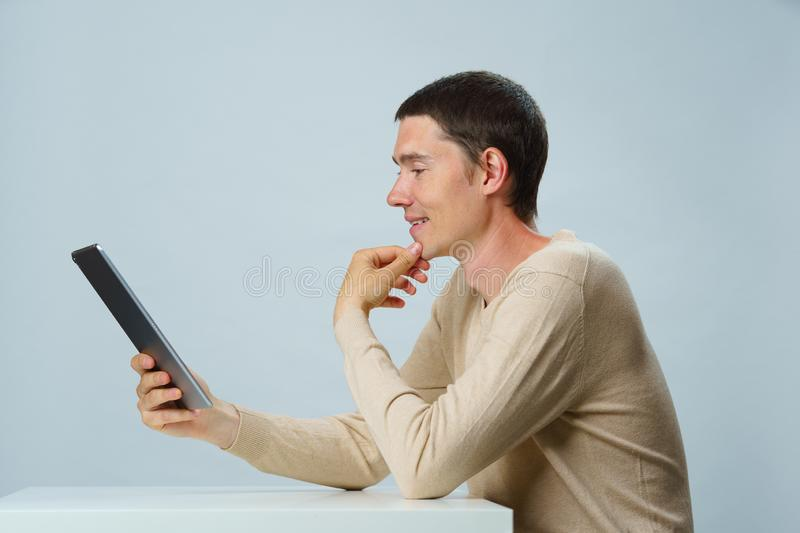 Man is using tablet computer for communication in chat or video chat. Social media concept. royalty free stock images
