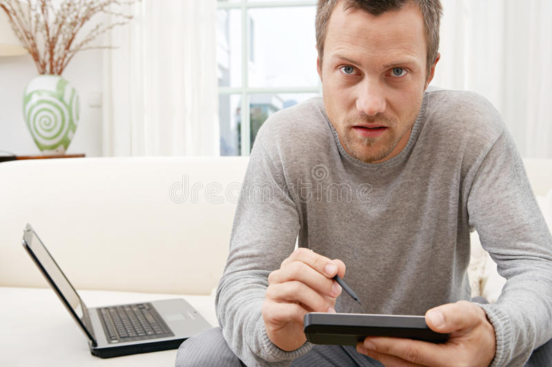 Download Man Using Tablet And Computer On Sofa At Home. Stock Image - Image: 29315603