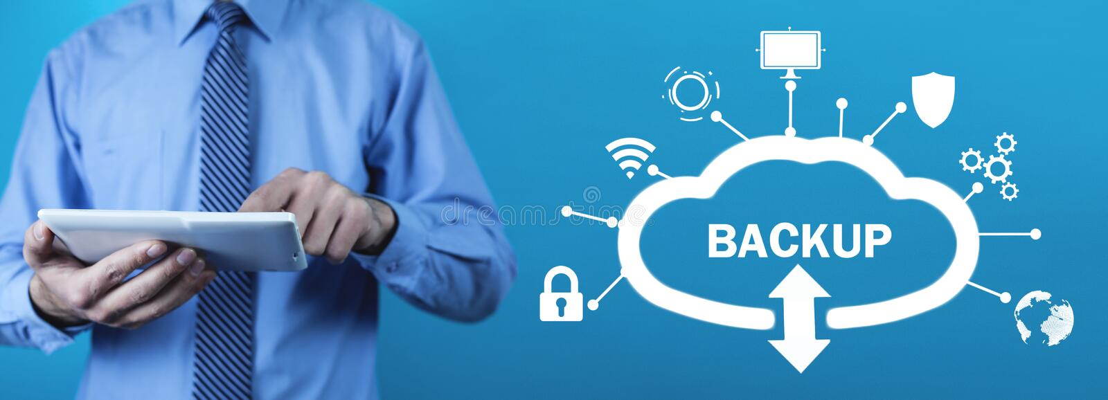 Man using tablet. Data Backup. Cloud Download. Internet, Technology stock photography