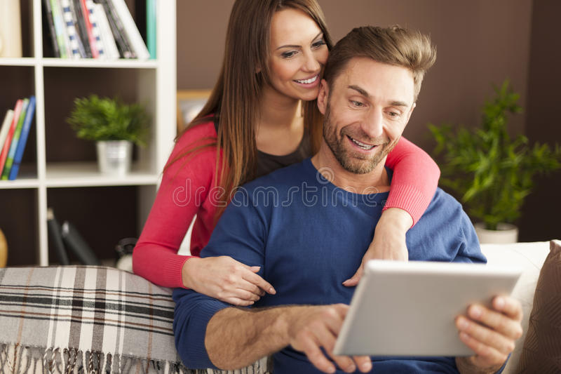 Man using tablet with his wife