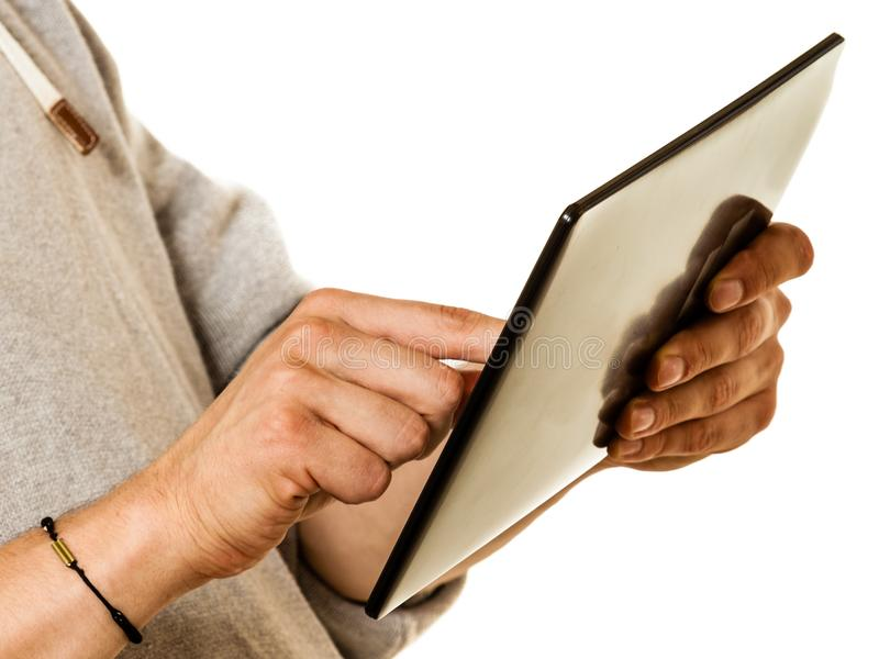 Man using tablet pc computer, new technology concept. Man using tablet pc computer, hands only. New technology and modern devices concept stock photography